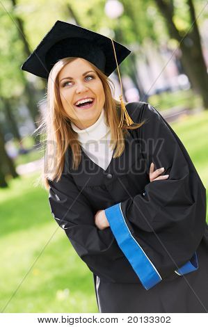 female graduate student in the park cheerful and happy