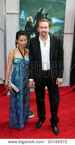 "NEW YORK - JULY 6: Actor Nicolas Cage and wife Alice Kim attend the premiere of ""The Sorcerer's Apprentice"" at the New Amsterdam Theatre on July 6, 2010 in New York City."