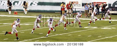 EAST RUTHERFORD, NJ - AUGUST 16: New York Giants kicker Lawrence Tynes leads the kickoff against the New York Jets at the new Meadowlands arena on August 16, 2010 in East Rutherford, New Jersey.