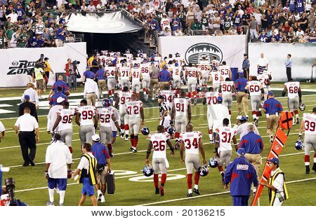 EAST RUTHERFORD, NJ - AUGUST 16: The New York Giants retreat to the locker room at halftime against  the New York Jets at the new Meadowlands arena on August 16, 2010 in East Rutherford, New Jersey.