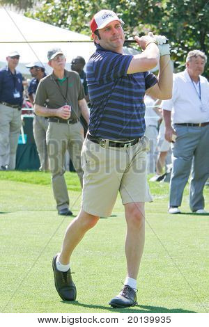 ORLANDO, FL - MARCH 23: Jay DeMarcus of Rascal Flatts tees off during a practice round at the Arnold Palmer Invitational on March 23, 2011 at the Bay Hill Club and Lodge in Orlando, Florida.