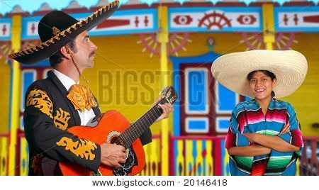 Mexican mariachi charro man and poncho Mexico girl colorful facade houses