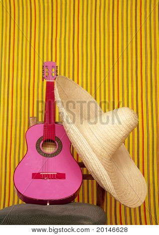 charro mexican hat pink guitar in striped background