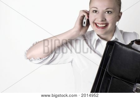Beautiful Businesswoman With A Bag Using Mobile Phone