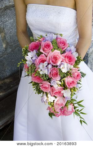 bride with long pink bouquet