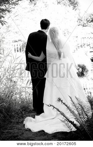 monochromatic bride groom in garden