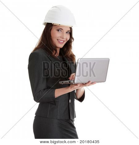 Smiling young female architect holding small laptop, isolated on white background