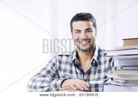 Young Student Smiling With Books On White Background