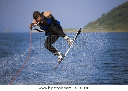 Jumping Wakeboarder In Water Splash