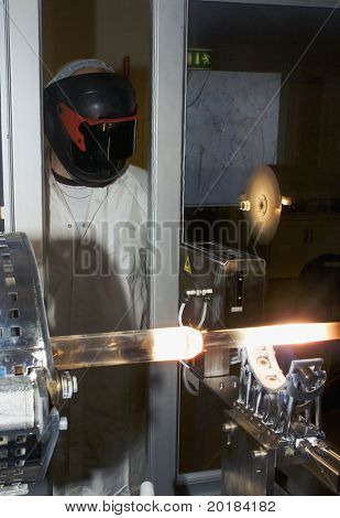 Technician producing fibreoptics with protection