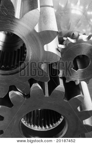three different gears, cogs in black/white