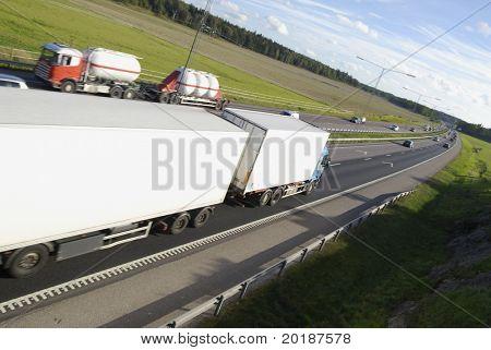 trucks, lorries meeting on highway