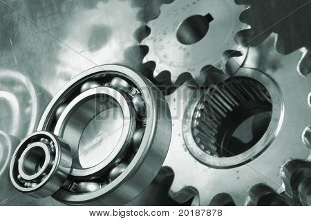 gears and bearings connecting in a greenish metallic tint