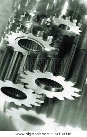 gears, pinion machinery seen from above, in a green metallic cast