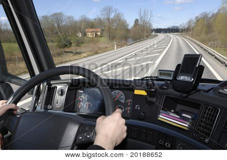 truck-drivers view of oncoming highway from inside cabin