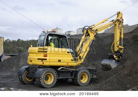 bulldozer, digger excavating earth and stone
