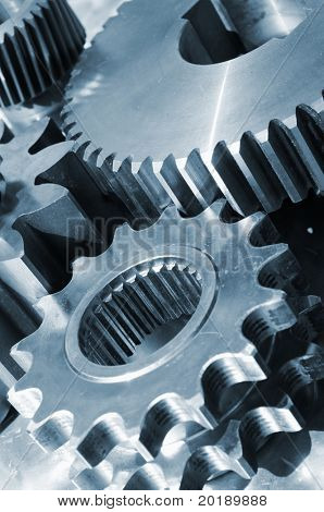 industrial gear parts in action, titanium based and in a bluish toning concept