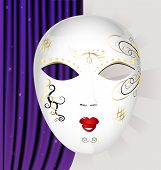picture of mummer  - on an abstract background of a large white Venetian mask with black and gold pattern - JPG