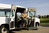 foto of handicap  - handicapped man operating a wheelchair lift van - JPG