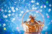 gift basket with festive particles, blue background poster