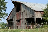 stock photo of wanton  - This is a very large worn barn on a country farm - JPG