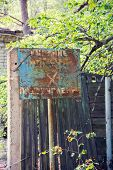 Old Rusty Metal Signs In The Chernobyl Zone. Radioactive Area. Warning About Dangerous Area poster