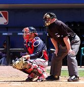 PORT ST. LUCIE, FLORIDA - MARCH 23: Atlanta Braves catcher Brian McCann sits behind home plate durin