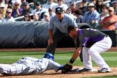 SCOTTSDALE, AZ - MARCH 7: Los Angeles Dodgers outfielder Tony Gwynn Jr avoids a tag by Colorado Rock
