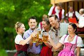 stock photo of lederhosen  - In Beer garden in Bavaria - JPG
