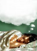 Young girl sleeping in her bed, with a dreaming fluffy balloon above her head poster