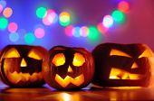 Halloween Pumpkins Head Jack-o-lanterns With Lights On Background poster