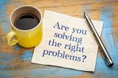 Are you solving the right problems? Handwriting on a napkin with a cup of espresso coffee poster