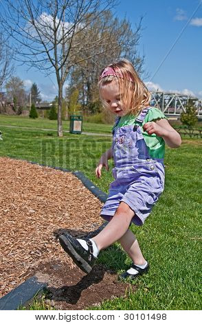 Toddler Girl Is Stomping Dirt