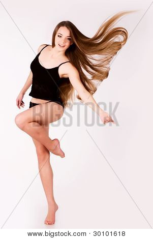 a beautiful young girl with a long hair