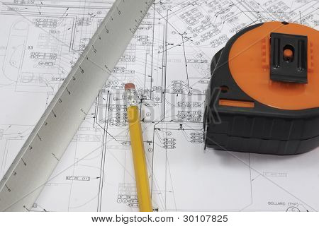 Pencil, Scale, And Tape Measure On Plans