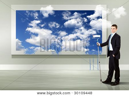 Young businessman and nature background