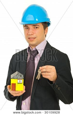 Engineer Holding Miniature Home And Keys