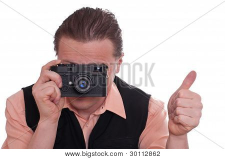 Photographer With Camera Is Holding Up His Thumb