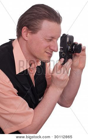 Photographer Is Looking Through A Camera