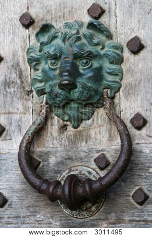 Old Iron Knocker On Wooden Castle Door