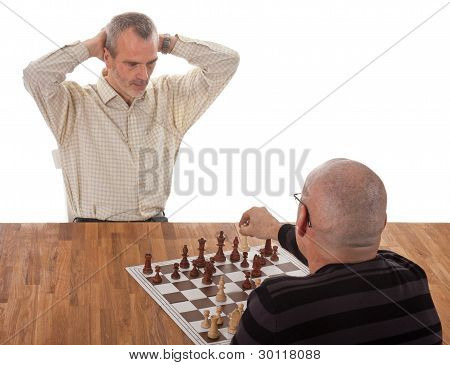 One Chess Player Checkmates The Other; Isolated On White