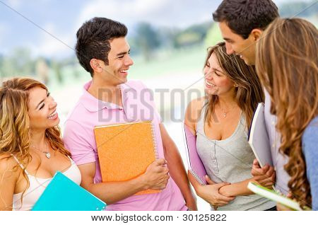 Friendly group of students talking and having fun - outdoors
