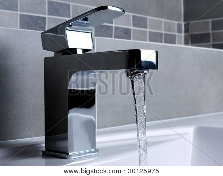 Modern bathroom chrome faucet with running water