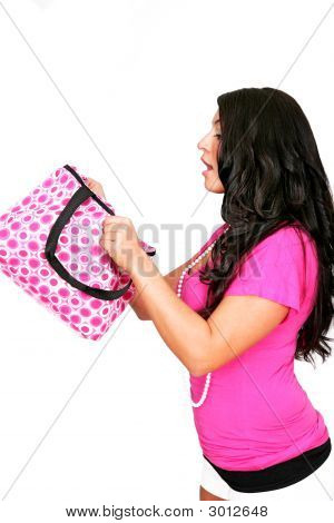 Girl In Pink Looking Inside Bag