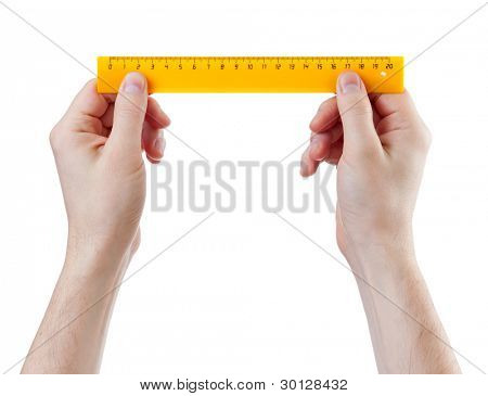 yellow centimeters ruler in hands measure isolated on white