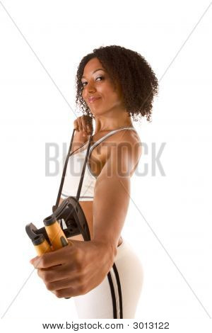 Dark Skinned Female Exercising With Resistance Band (Selective Focus On Face)