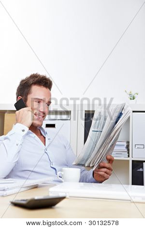 Business man on job search reading appointments section and making calls