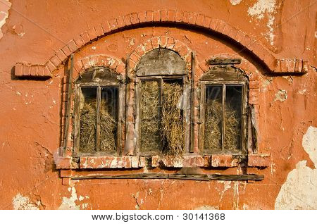 Historical Manor Building Windows With Straw