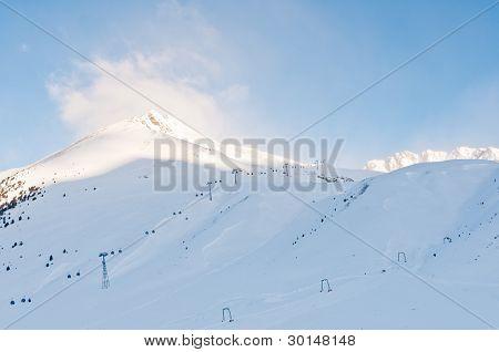 Sunrise At An Alpine Ski Piste In Winter