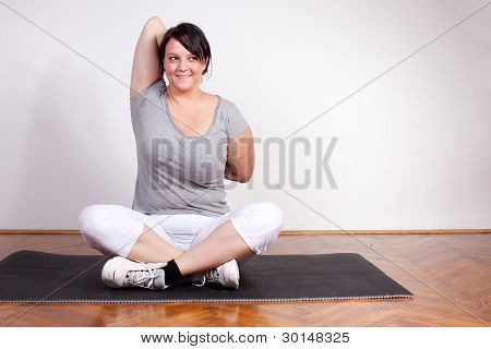 Overweight Woman Exercising/stretching
